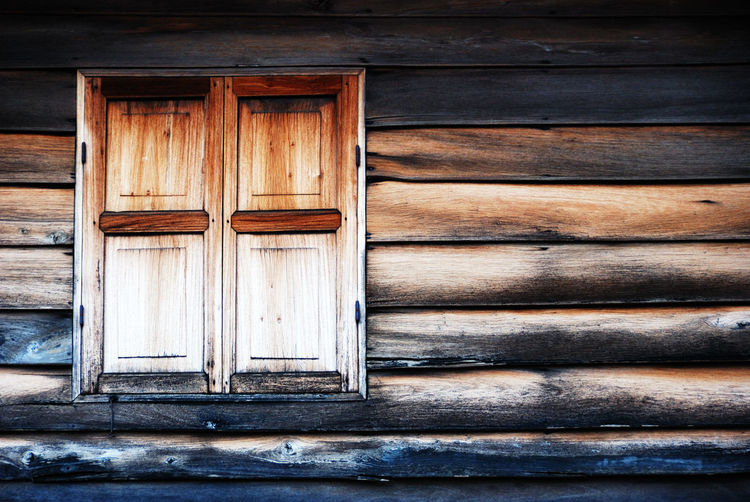 Low Angle View Of Closed Wooden House Window