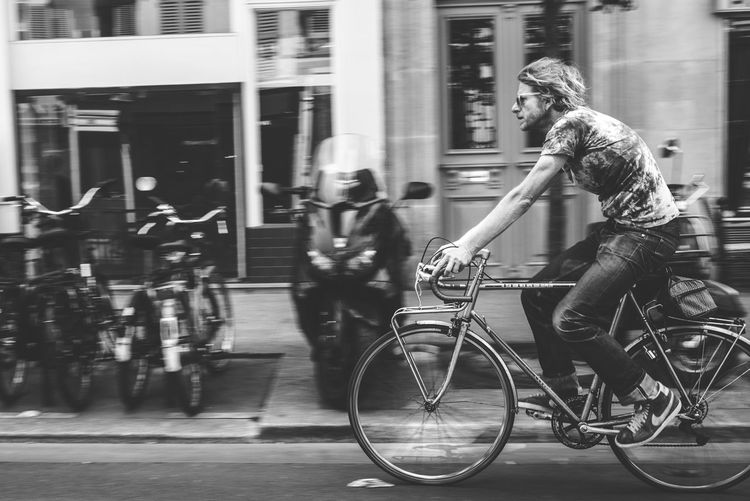 Bicycle Transportation Mode Of Transport Full Length City Life City Casual Clothing Building Exterior Street Outdoors Real People Land Vehicle One Person Day Built Structure Road Standing Men Architecture Lifestyles EyeEm Best Shots From My Point Of View