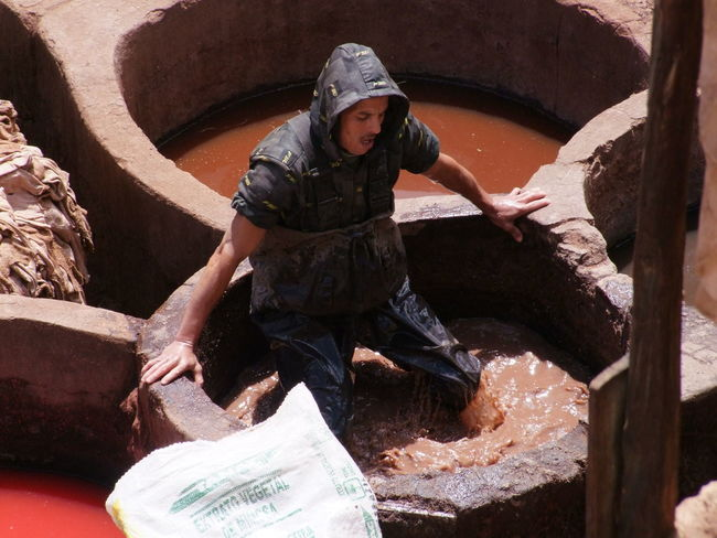 Treading in the Dye, Medina Composition Dye Dyeing Famous Place Fes Full Frame High Angle View Hoodie Leather Making A Living Medina Medina De Fez Morocco Old City One Man Only One Person Outdoor Photography Sheepskin Skins Sunlight And Shadow Tourist Attraction  Treading Water Water Worker Working