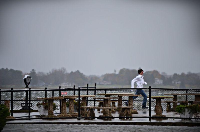 Leisure Activity Lifestyles Outdoors Railing Shoreline Sky