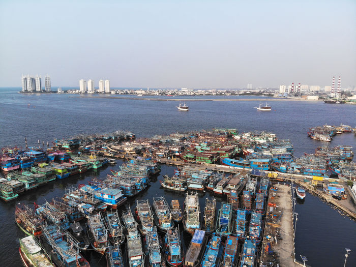 Aerial View of Muara Angke Fishing Harbor Container Ship Unloading Crane - Construction Machinery Moored Loading Cargo Container Shipping  Industrial Ship Nautical Equipment Mast Construction Dock Freight Transportation Rotterdam Boat Coastline