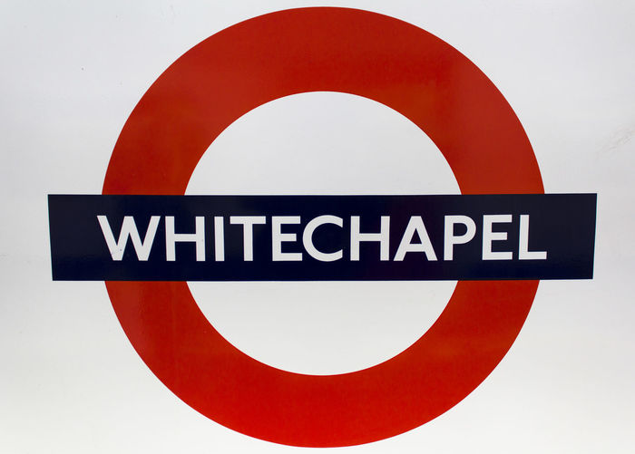 Close-up of sign against white background