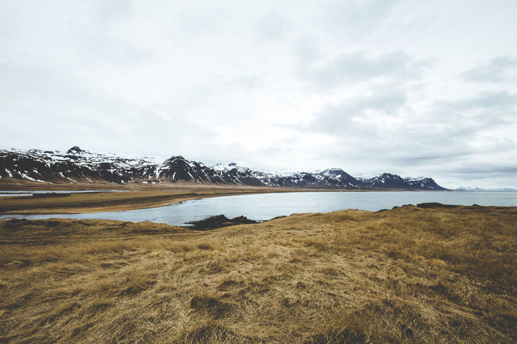 Days of travel: 4 - Western Region, Snæfellsnes Peninsula Iceland Landscape_Collection Snaefellsnes Peninsula Beauty In Nature Cloud - Sky Cold Temperature Day Environment Grass Lake Landscape Mountain Mountain Peak Nature No People Outdoors Range Scenics - Nature Sky Snow Snowcapped Mountain Tranquil Scene Tranquility Water Winter The Great Outdoors - 2018 EyeEm Awards My Best Travel Photo