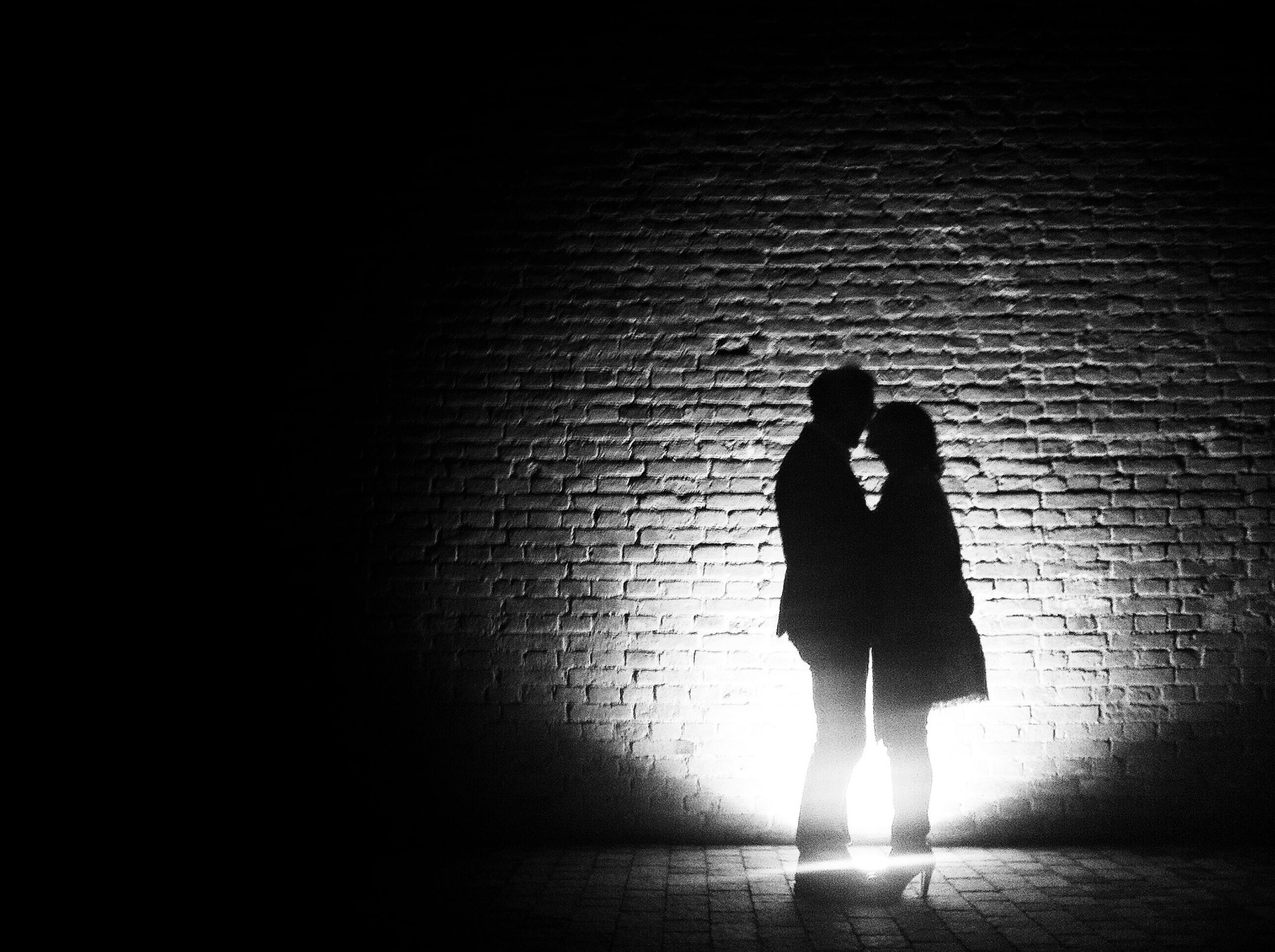 silhouette, lifestyles, full length, standing, men, leisure activity, walking, shadow, night, rear view, wall - building feature, architecture, built structure, dark, person, sunlight, wall
