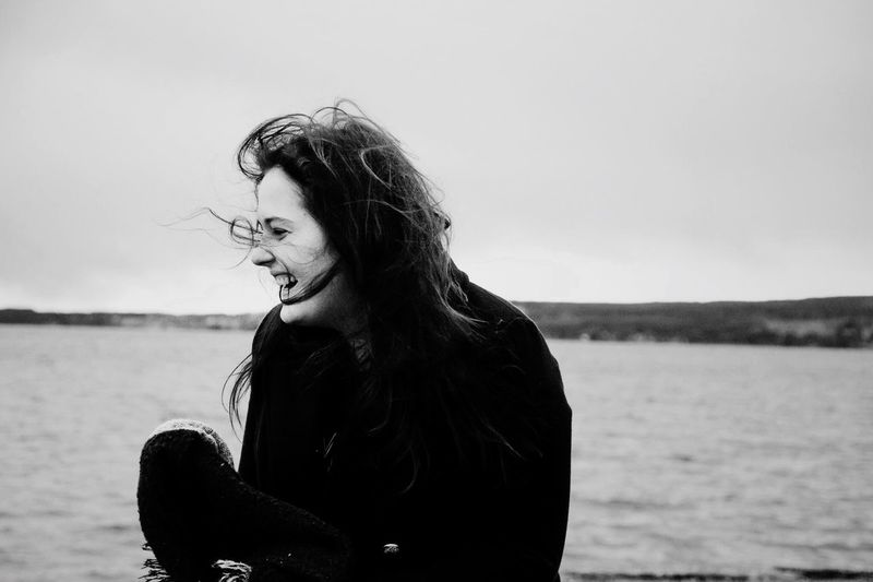 Be. Ready. EyeEm Selects Laugh more. Love more. Real People One Person Water Sea Beach Young Women Leisure Activity Lifestyles Long Hair Young Adult Outdoors Nature Sand Day Sky Horizon Over Water Clear Sky People