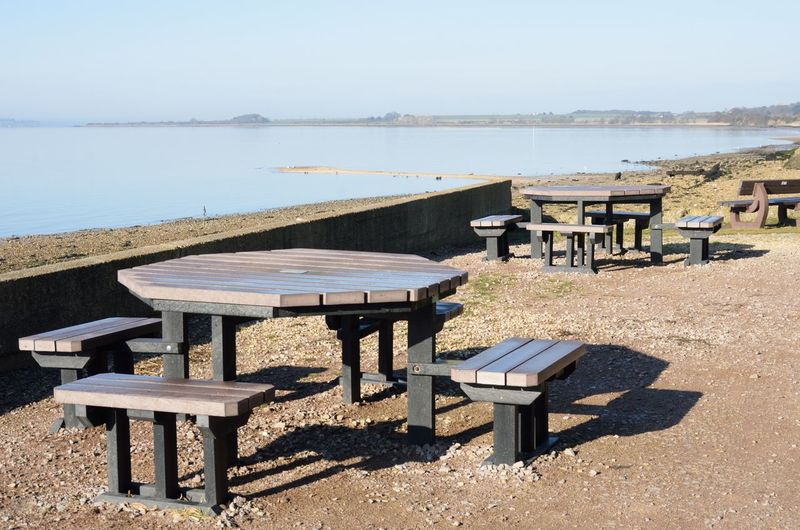 Empty coffee tables outside Seat Bench Nature Outdoor Tables Tables And Chairs Table And Chairs At The Sea Coffee Tranquil Scene