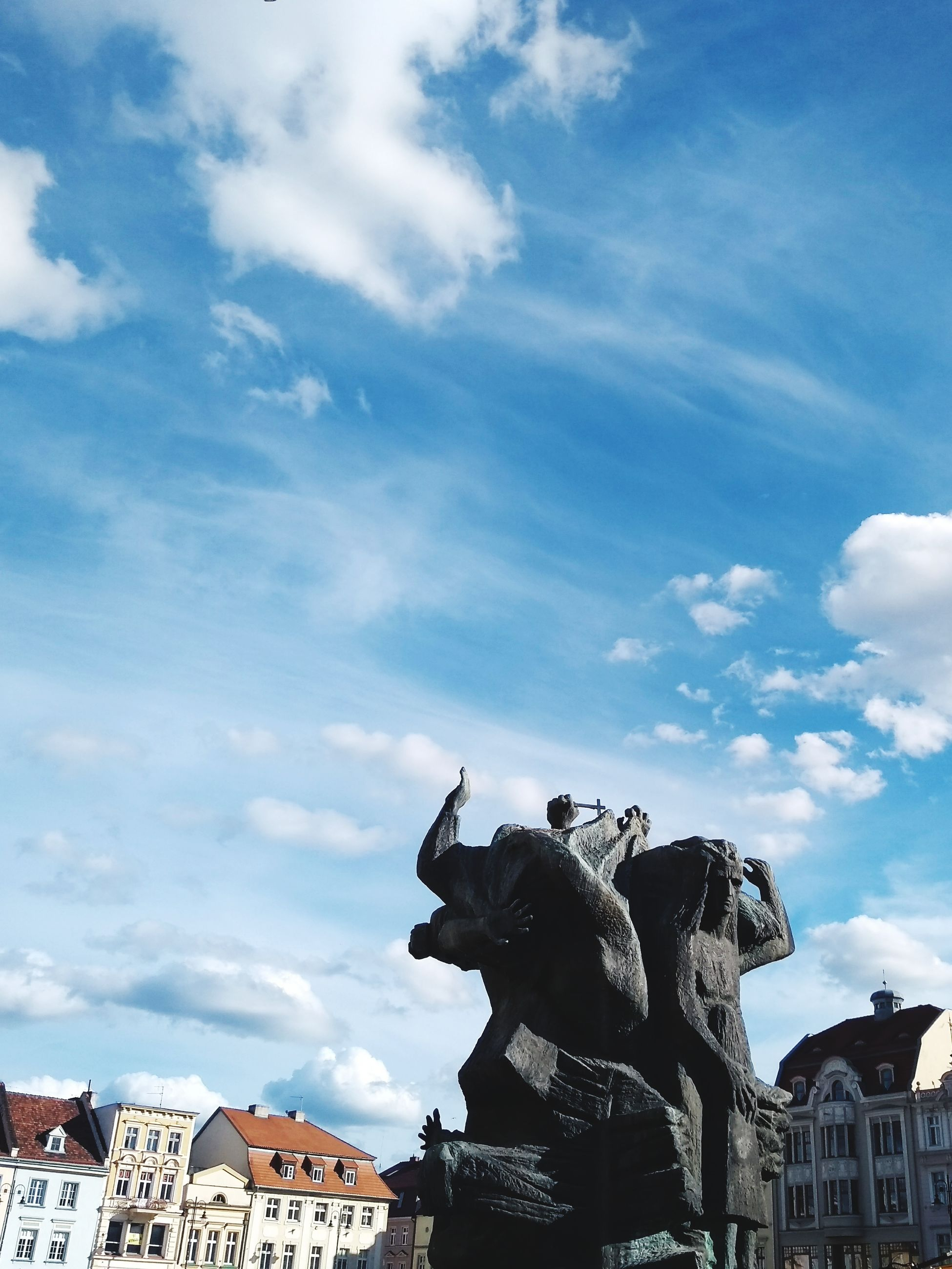 cloud - sky, sky, representation, architecture, sculpture, art and craft, statue, creativity, built structure, no people, building exterior, craft, day, mammal, nature, low angle view, human representation