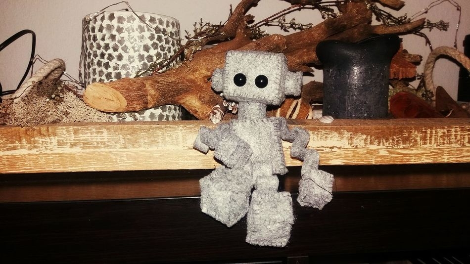 Indoors  Christmas Decoration No People Day Close-up Robot FeltCraft Toy Decoration Christmas Time Christmas Ornaments Christmas Ornament Table Top Photography Handcrafted Sewing Handsewing Handsewn Grey Felt Candles
