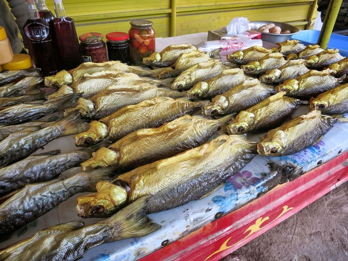 High Angle View Of Raw Fish Arranged On Market Stall