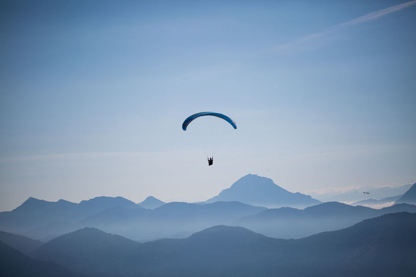 Lenggries Adventure Beauty In Nature Day Extreme Sports Flying Freedom Leisure Activity Mid-air Mountain Mountain Range Nature Non-urban Scene Outdoors Parachute Paraglider Paragliding Scenics - Nature Sky Sport Tranquil Scene Tranquility Unrecognizable Person