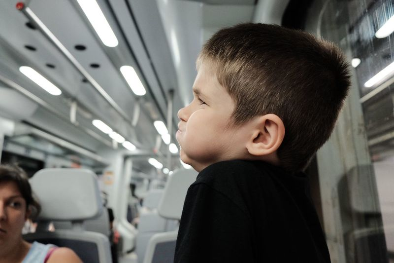 EyeEm Selects Indoors  Real People Boys Childhood One Person Headshot Public Transportation Elementary Age Transportation Lifestyles Close-up Day People