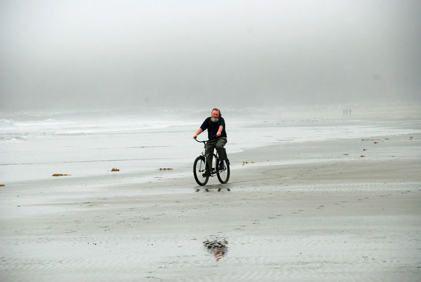 Cycling On Beach Man With Beard Adventure Beach Beauty In Nature Day Full Length Headwear Leisure Activity Lifestyles Misty Morning Nature One Man Only One Person Outdoors People Real People Riding Sand Scenics Sea Sky Sport Transportation Water