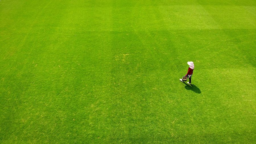 High angle view of man walking on grass