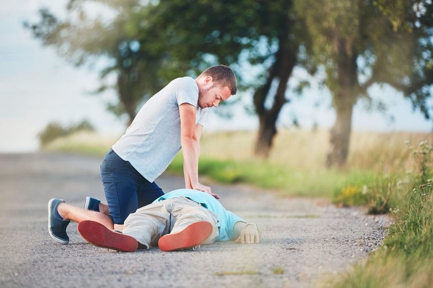 Dramatic resuscitation on the rural road. Themes rescue, help and hope. CPR  Death Emergency First Aid Hope Life Man Road Accident Accidents And Disasters Action Cardiac Danger Emotion Health Healthcare And Medicine Heart Attack Help Ill Misfortune Outdoor Rescue Resuscitation Sick Urgency