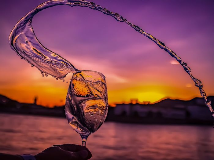EyeEm Selects Sunset Water Drop Sky Arts Culture And Entertainment Drink Bubble Close-up No People Beauty In Nature Multi Colored Bokeh Photography Defocused Night Outdoors Nature Bubble Wand