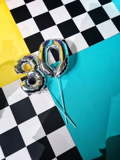 From the third floor. Checked Pattern 30th Numbers Textures And Surfaces Backgrounds Thirty Yellow Color Chess Board Chess Textured  Number 30 Balloons Silver Balloons The Still Life Photographer - 2018 EyeEm Awards