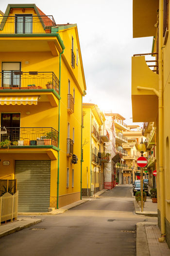 Italy Sicily Architecture City Building Exterior Yellow Built Structure Street Sky The Way Forward Building Residential District Direction Transportation City Life Day Outdoors Nature Road Cloud - Sky Footpath No People Alley