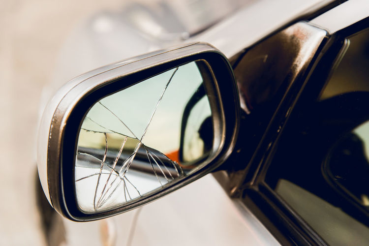 Broken left car door mirror Due to bumps Mode Of Transportation Land Vehicle Transportation Reflection Car Motor Vehicle Side-view Mirror Focus On Foreground No People Close-up Day Glass - Material Outdoors Mirror Travel Selective Focus Metal Window Motion Vehicle Mirror Broken Mirror Bad Condition Bumps Leftbehind