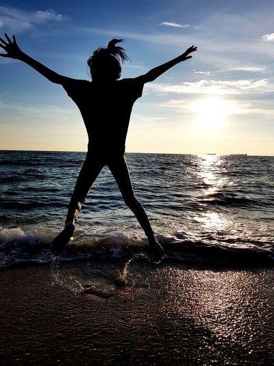 star Child Jumping Jumpshot Water Sea Athlete Sunset Full Length Flexibility Legs Apart