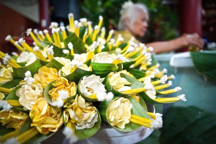 Flowers and candles wrapped in banana leaf for loi krathong festival