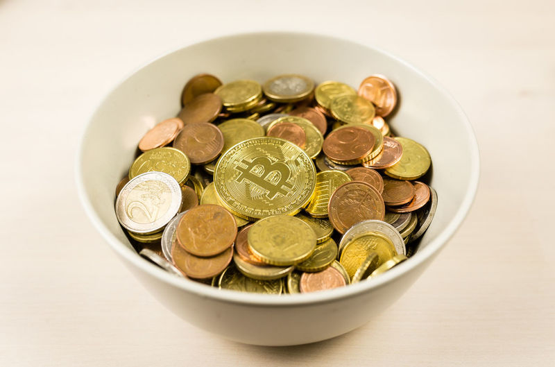 High angle view of coins in plate