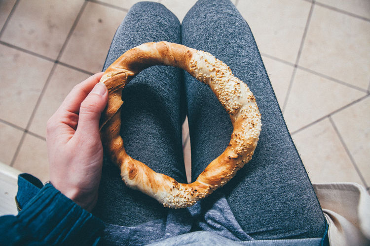 Mid section of a woman holding pretzel