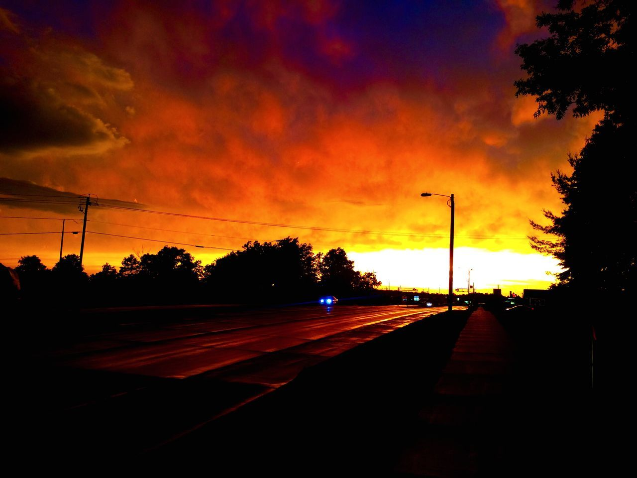 sunset, silhouette, transportation, cloud - sky, sky, tree, car, road, dramatic sky, no people, orange color, the way forward, nature, mode of transport, land vehicle, street light, scenics, beauty in nature, outdoors, day