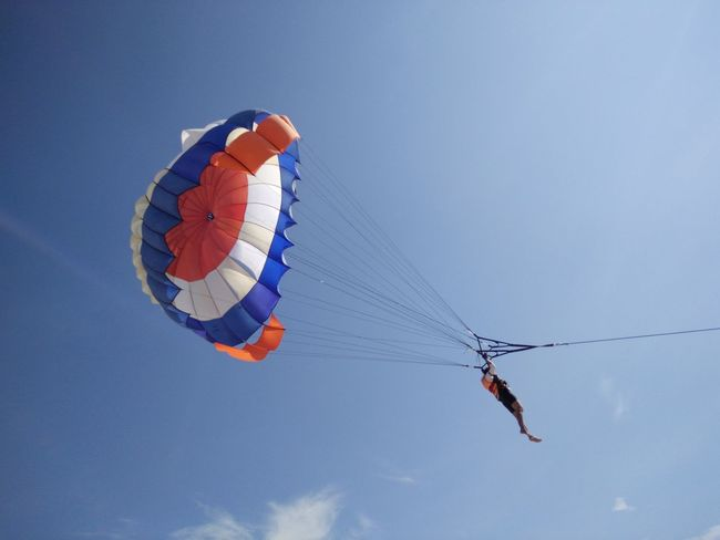 Adventure Airshow Blue Day Enjoyment Extreme Sports Flying Freedom Fun Leisure Activity Low Angle View Mid-air Multi Colored Outdoors Paragliding Sky Parasailing Watersports Nusadua Tanjungbenoa Bali, Indonesia Shore