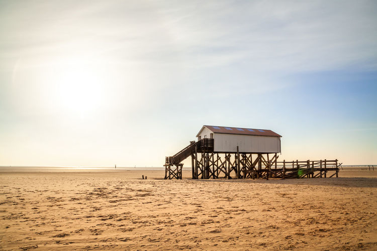 Lifeguard hut at beach against sky