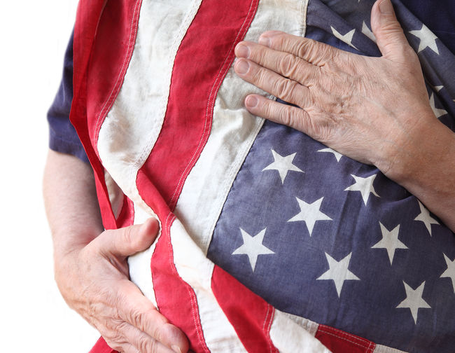 Midsection Of Man Holding American Flag