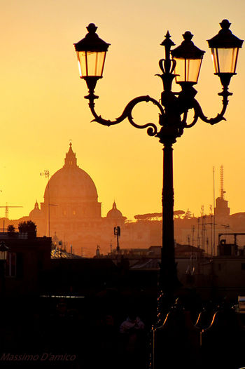 San Pietro In Vaticano Cupola Di San Pietro Street Light Lighting Equipment Sunset Building Exterior Silhouette Built Structure Architecture Dome Dusk City Lamp Post Old-fashioned Clear Sky Sun Electric Light Outdoors Gas Light Orange Color Waterfront Sky