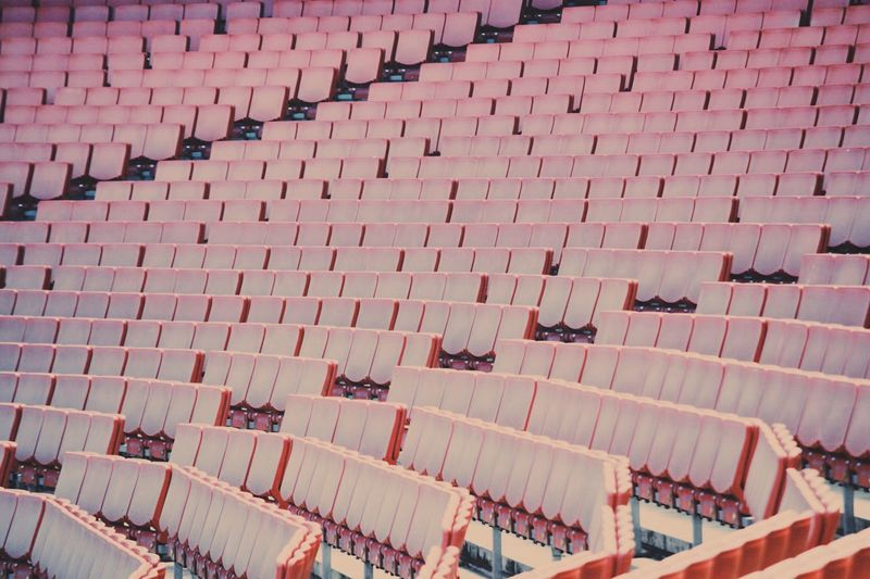 EyeEm LOST IN London High Angle View Full Frame Backgrounds Outdoors No People Day Architecture Building Exterior Arsenal Stadium Football Seats Empty Red Chairs Fans Soccer Stadium London England Sports Empty Chair Open Edit The Week On EyeEm Editor's Picks The Graphic City