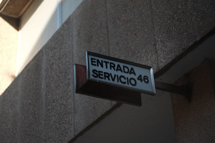 Service entrance of a building. In rich neighbourhoods of Barcelona built in '60s and '70s there are still separate doors and stairs for the domestic service of the apartments Architecture Building Exterior Built Structure Domestic Services Low Angle View No People Sign Street Streetphotography Text