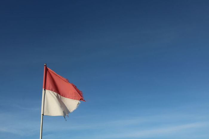 original flag of Indonesia Flag Blue Sky Red Nature Patriotism Day Copy Space No People Low Angle View Wind Environment Pole Outdoors Clear Sky Emotion Waving Beauty In Nature Pride Independence National Icon INDONESIA