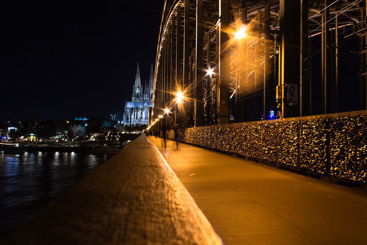 Long exposure shot of Hohenzollern bridge in Cologne with Cologne Cathedral in background and blurred people moving Illuminated Night City Architecture Street Built Structure Street Light No People Transportation Lighting Equipment Outdoors Building Exterior Nature Cologne Cologne Cathedral Hohenzollernbrücke Hohenzollernbridge Motion Blur Love Lock