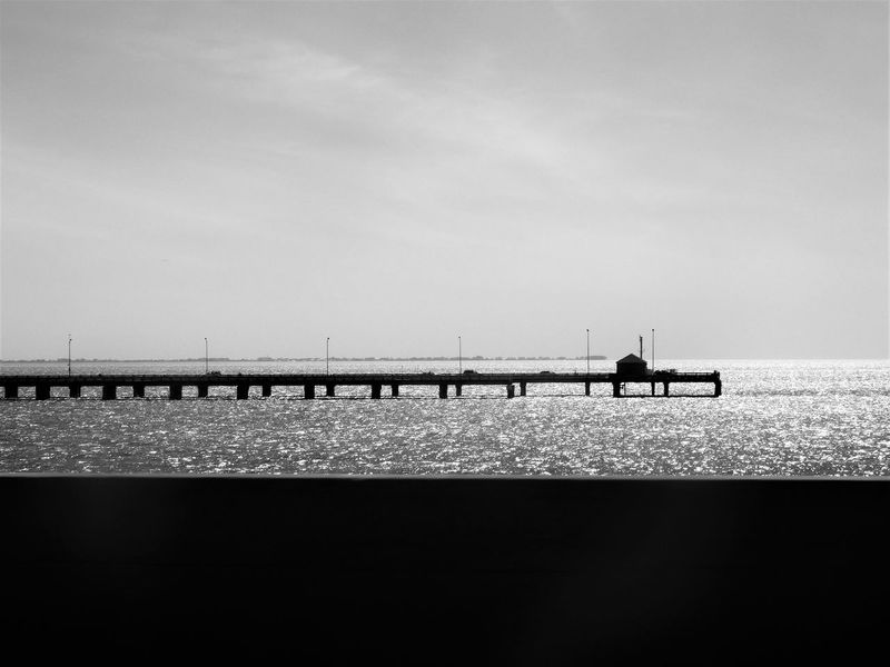 What remained of the old Sunshine Skyway Bridge after it was destroyed by a fatal accident years ago was made into a pier next to the rebuilt bridge. Beauty In Nature Bridge Calm Cloud Coastline Day Florida Horizon Over Water Nature Ocean Outdoors Outline Pier Relaxation Remote Scenics Sea Sky Solitude Sunshine Skyway Bridge Tranquil Scene Water Historical Landmark History Through The Lens  Monochrome Photography