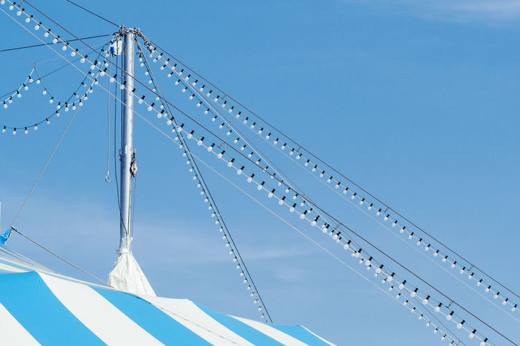 The Circus is Coming to Town! Circus Lights Architecture Blue Built Structure Circus Tent Clear Sky Connection Copy Space Day Lightchain Low Angle View Minimalism Minimalobsession Nature No People Outdoors Sky Sunlight