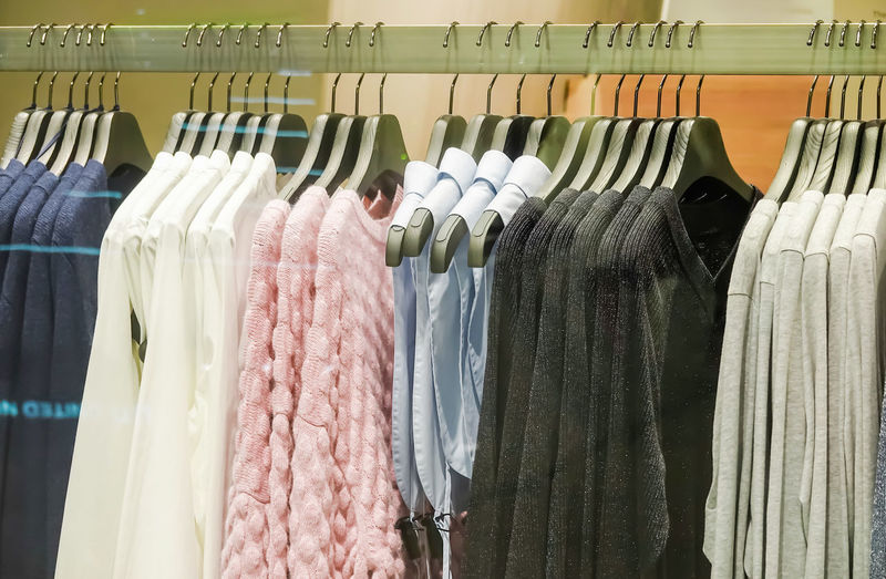 Panoramic shot of clothes for sale in store