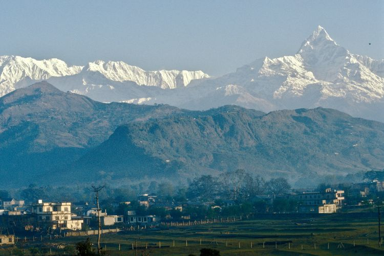 """1987 old analogue phtograpy of the Pokhara valley at sunrise, with Annapurna mountain ranhe and """"Fishtail"""" Machapuchare (6.997 m) Analogue Photograhy Annapurna Massiv Beauty In Nature Gandalf-Tal Landscape_photography Mountain Mountain Range Nature Nepal 1987 No People Old Photos With History Pokhara Valley Pokhara, Nepal Scenics Travel Destinations Travel Photography Nepal Travel Annapurna Mountain Range Himalaya"""