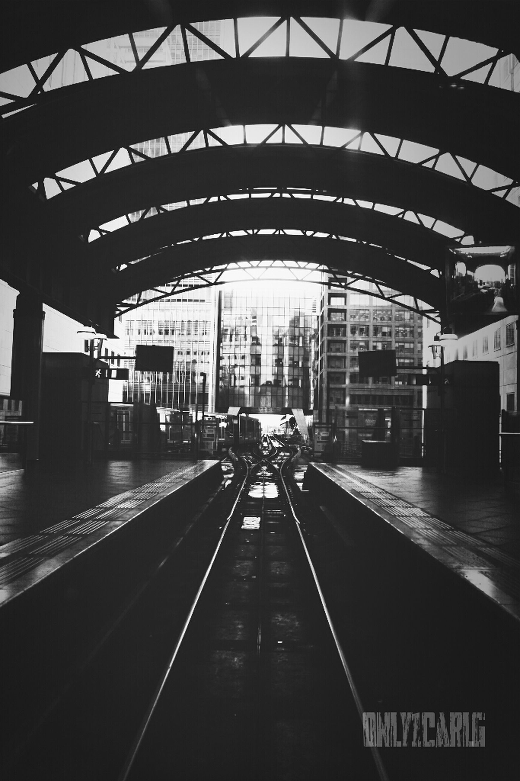 architecture, transportation, built structure, indoors, railroad station, railroad station platform, rail transportation, public transportation, railroad track, the way forward, diminishing perspective, incidental people, empty, ceiling, city, travel, vanishing point, building exterior, city life, transportation building - type of building