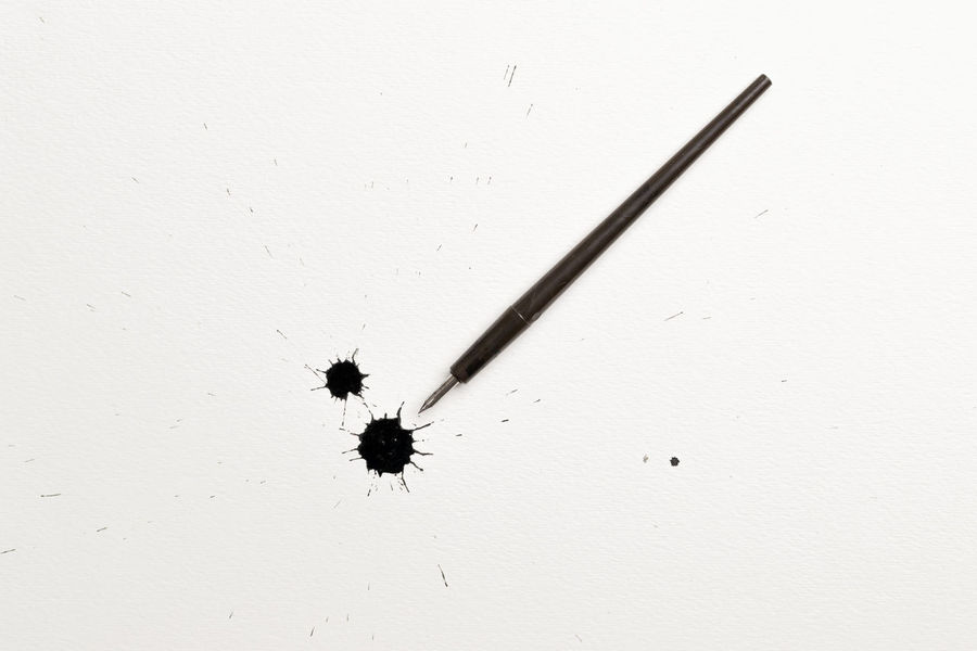 Spattered black ink spot with calligraphy pen on white background Check Mark Me Black Ink Calligraphy Pens Quill Radiating Spattered Spilled Spot White Background
