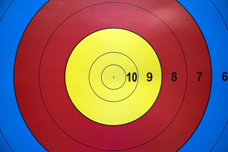 Archery Target Multi Colored No People Close-up Archery Archery Target Circle Shape Geometric Shape Sport Sports Target Red Yellow Blue Day Aiming Sky Design Outdoors Vibrant Color Sports Equipment Accuracy Goal Competition