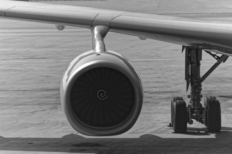 Airplane engine in a black and white Black & White Travel Wheel Wing Air Vehicle Aircraft Airplane Airplane Wing Avionics Blackandwhite Chrome Close-up Day Engine Engineering Gear Jet Engine Journey Landing Gear No People Outdoors Technology Transportation Turbine Airplane Mechanic Vehicle Part Runway Aircraft Wing Flying Flight The Traveler - 2018 EyeEm Awards