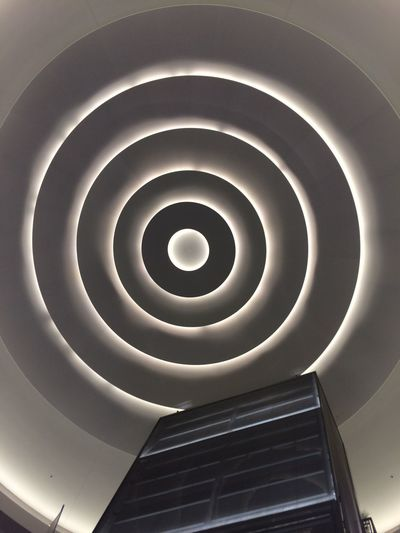 Architectural Feature Architecture Building Built Structure Ceiling Design Directly Below Elevators Geometric Shape Illuminated Indoors  Low Angle View Modern Pattern Shopping Mall