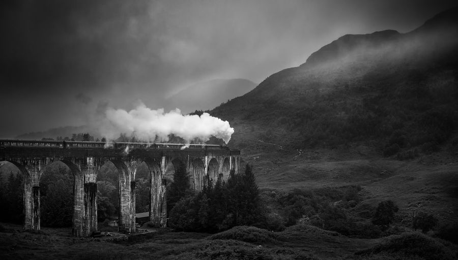 Glenfinnan Viaduct, Scotland, Highlands Architecture Day Factory Glenfinnan Glenfinnan Viaduct Harrypotter Mountain Nature No People Outdoors Sky Steam Train