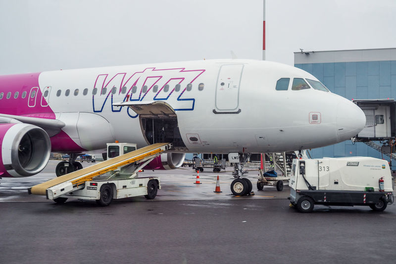 Airbus Lithuania Vilnius Airport Airplane Airport Airport Runway Day Land Vehicle Mode Of Transport No People Outdoors Passenger Boarding Bridge Stationary Transportation Vno Wizz Wizzair