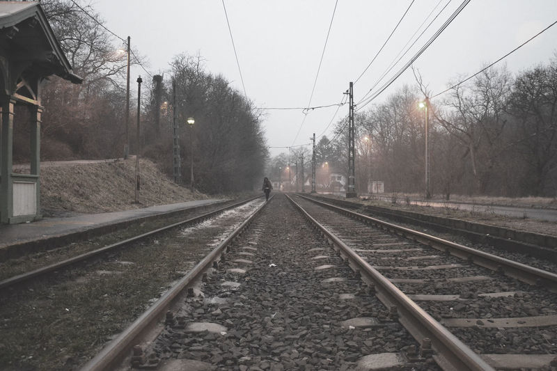 #alone #budapest #foggy #gilralone #tramstation #urban #urbantrip Day Nature No People Outdoors Rail Transportation Railroad Track Sky Transportation Tree