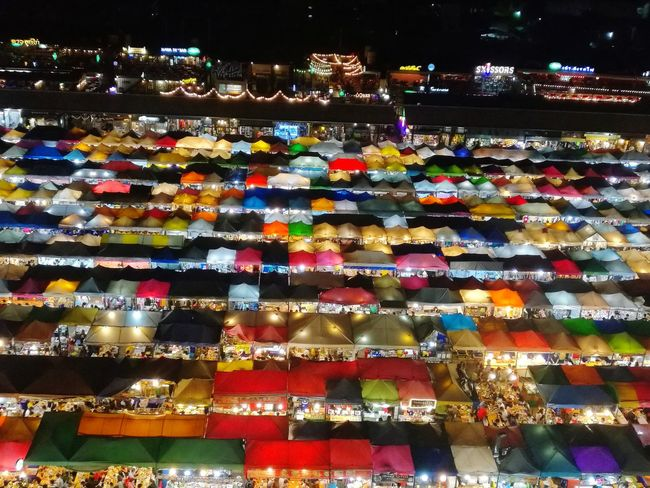 Night Market in Bangkok Thailand Umbrella Coulerful Guitar Sunset Sunlight Gas Station Sky And Clouds Sunrise EyeEm Selects Sunshine Sunset Silhouettes Blue Sky Pink Color Clouds And Sky Sjy Clouds Market Multi Colored Sky Market Stall Street Market Market Vendor Price Tag Farmer's Market Flea Market Display Retail Display Farmer Market Orange Color