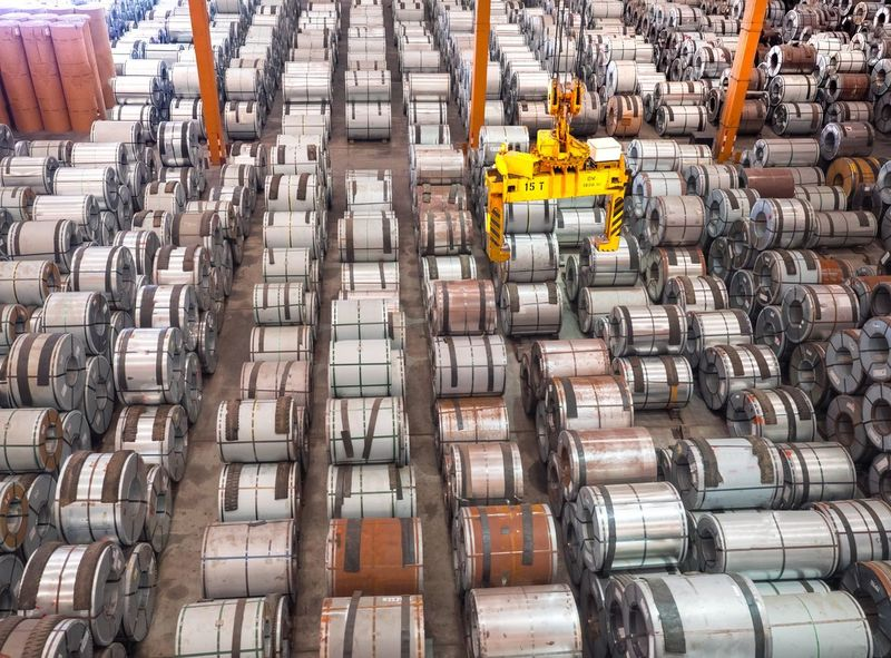 Industry Factory Metal No People Large Group Of Objects Efficiency Industrial Equipment Manufacturing Equipment Indoors  Day Petrochemical Plant coil Crane Tong Truck Pickup Stack Shipping  Delivery Industry Backgrounds Port Import Export Warehouse Transportation