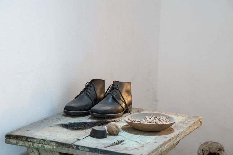 Pair of shoes on tiled floor